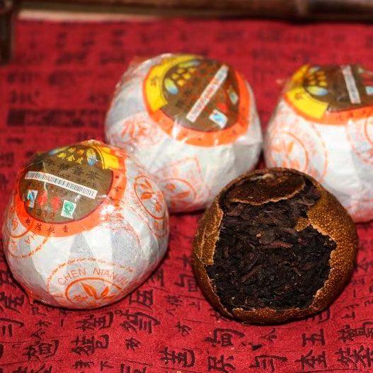 Шу пуэр  в мандарине Ju Pu («Оранжевый Пу»)