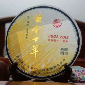 Shen puer Zolotoi yubilei fabrika Sinhai 2012 god